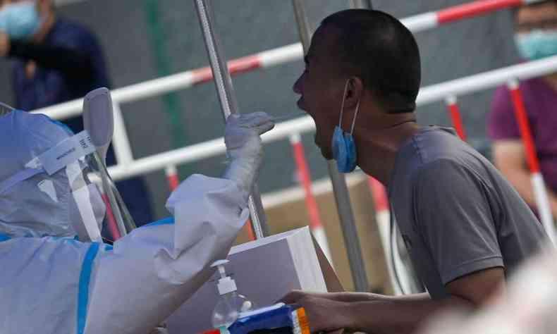 Não ficou claro por que a embaixada chinesa descreveu a doença como 'desconhecida' ou que informações possuía sobre a pneumonia(foto: WANG Zhao / AFP )
